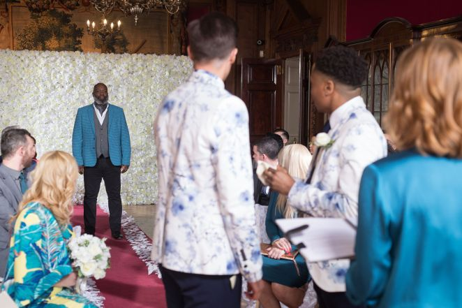 walter deveraux arrives at the wedding in hollyoaks