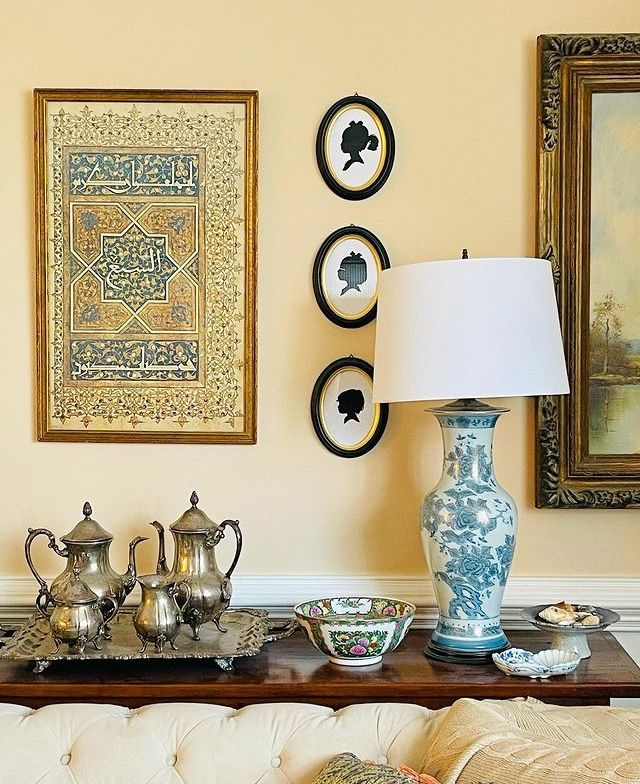 a design by may hussein, which includes islamic artwork that features a verse from the quran