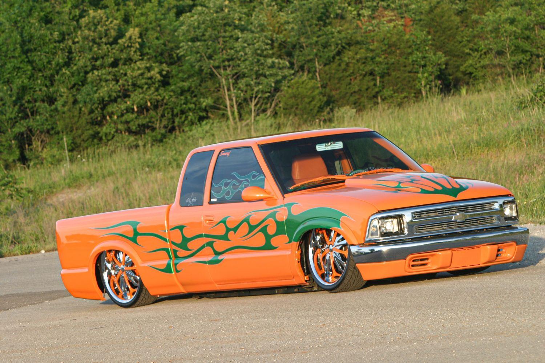 a bright orange mini truck