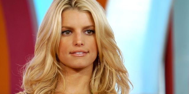 jessica simpson with red hair and bangs looks completely