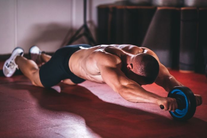 How to Use an Ab Roller to Train Your Core and Build a Six-Pack