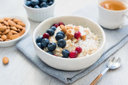 Oatmeal porridge bowl with blueberries, cranberries and almonds