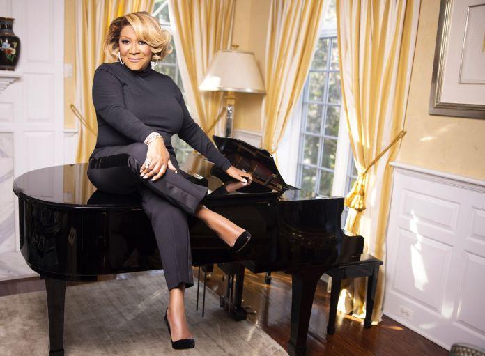 patti labelle sitting on a grand piano