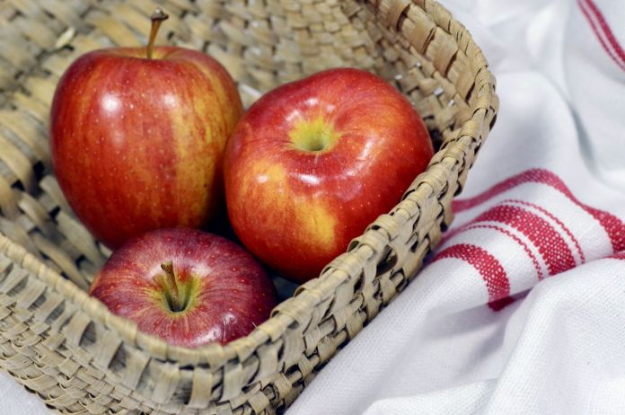 Theee Red Apples in a Picnic Basket