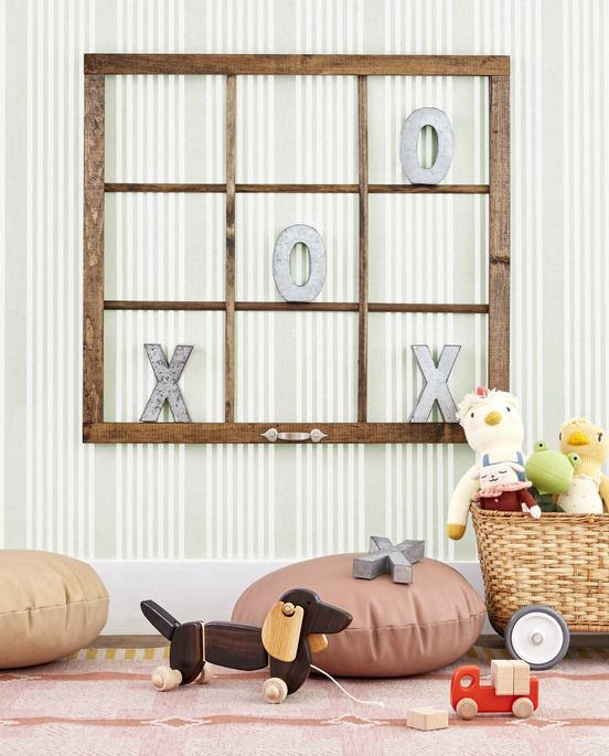 an old window with no glass becomes a tic tac toe game when hung on a wall