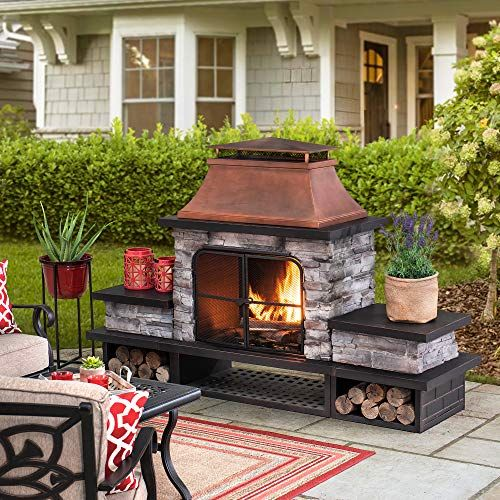 wood burning fireplace with copper chimney