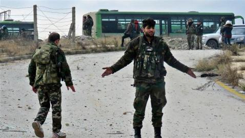 Syrian forces encircle militant-held area NW Damascus
