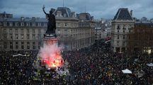 'Yellow vest' violence erupts across Europe: Paris riots spread to Brussels and Amsterdam as 1,400 are arrested, French police call up 8,000 reinforcements and rioters torch everything in their path