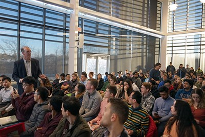 Students fill the Perry Atrium for the Tesla videoconference