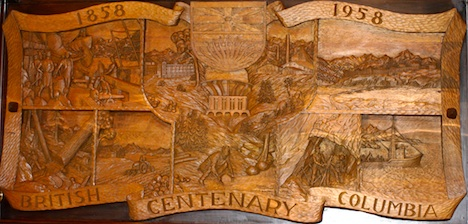 The elaborately carved coat of arms details the history of European settlement and early industries—grape growing not among them...