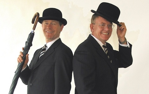 Broker's Gin founders martin and Andy Dawson in bowlers with brollies