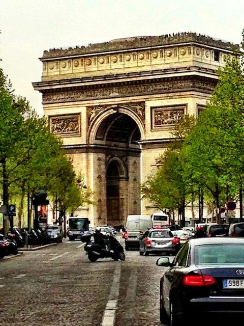 L'Arc de Triomphe, at the west end of Les Champs-Elysées, source Paris Digest