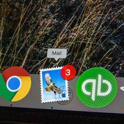 Mail app icon highlighted on a Macbook