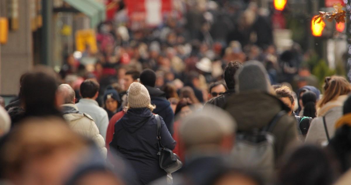 Crowd of people walking street