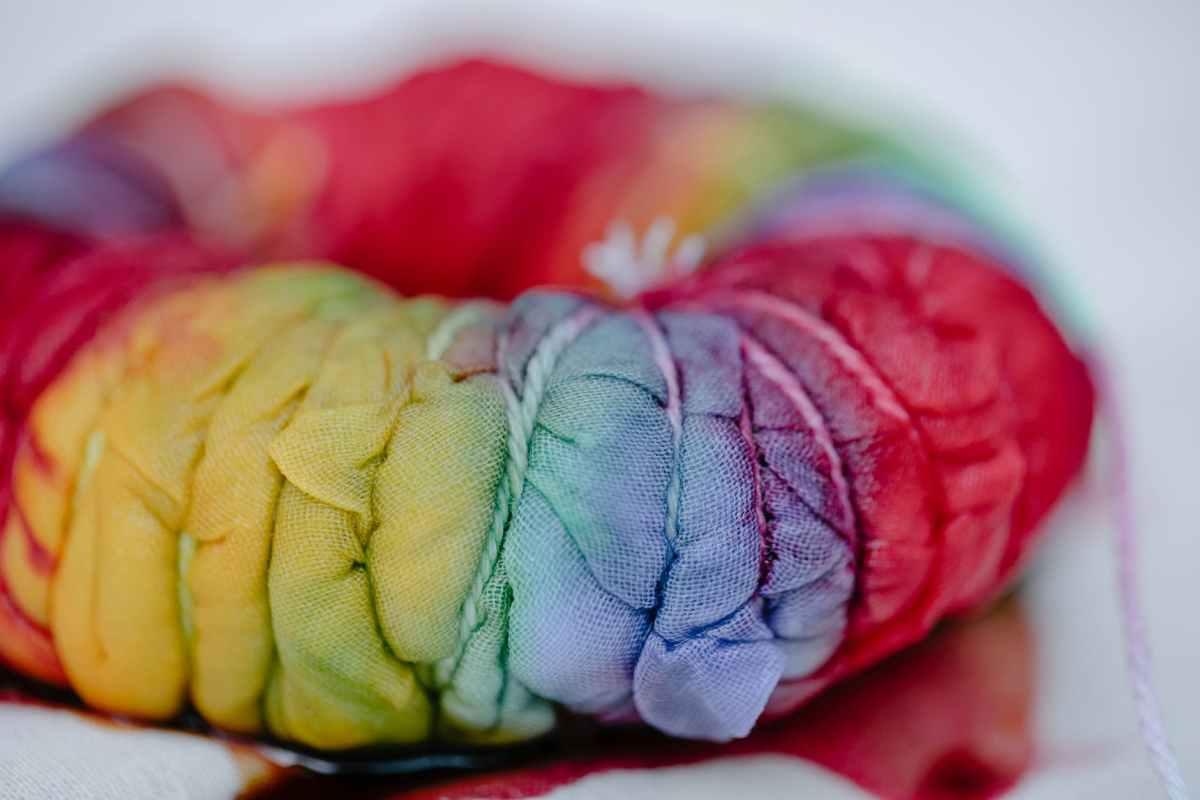 pleated textile with colorful paints representing shibori technique