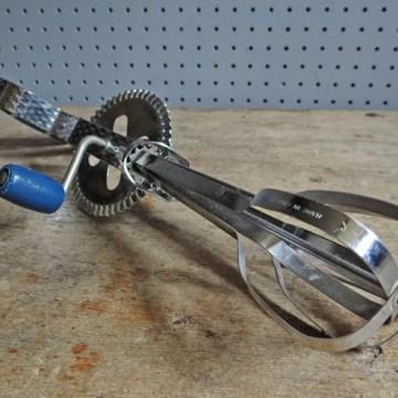 Vintage blue-handled whisk