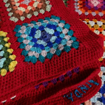 Red granny square blanket