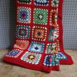 Red granny square blanket