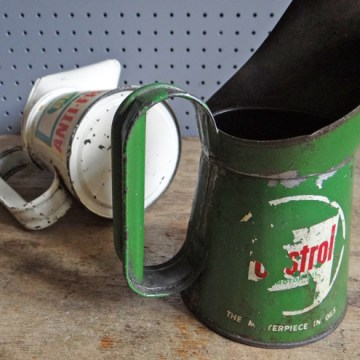 Pair of automotive oil cans