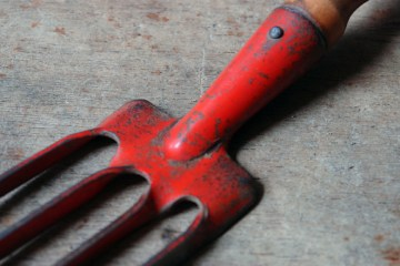 Red-painted garden fork