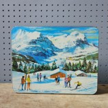 Vintage skiing biscuit tin