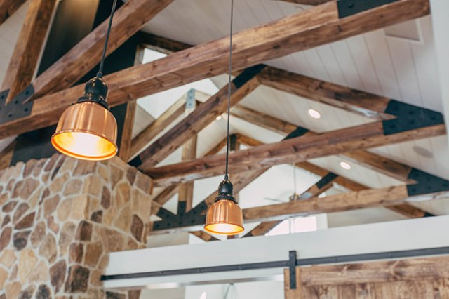 Rustic wooden rafters and stone wall