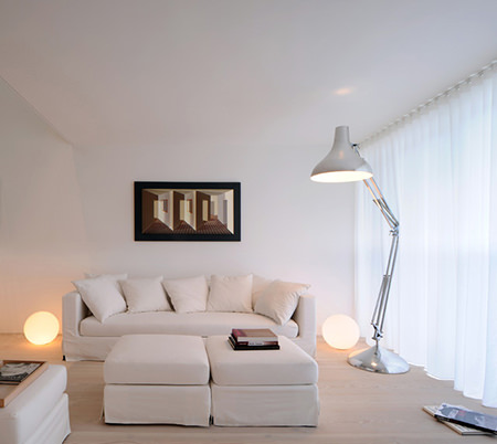 White sitting room with white curtains closed