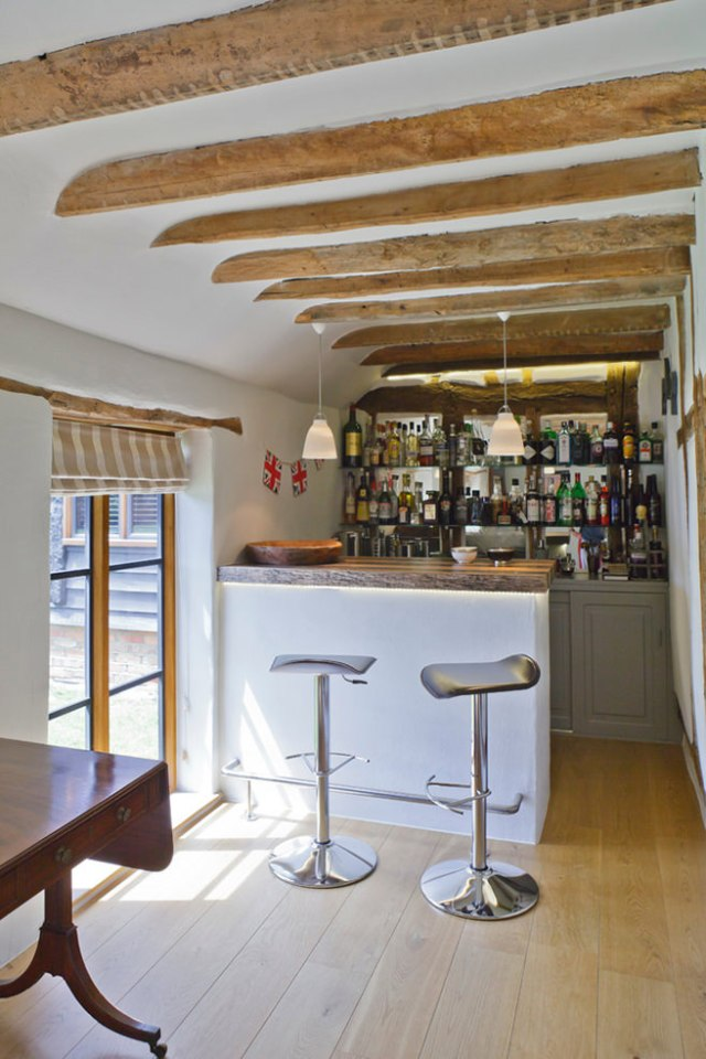Country home bar with beamed ceiling