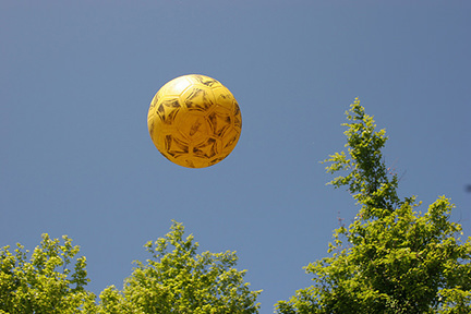 yellow football against a blue sky