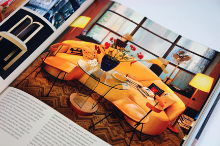 "page from the book, ""70s Style & Design"" showing a sitting room with a large yellow sofa"