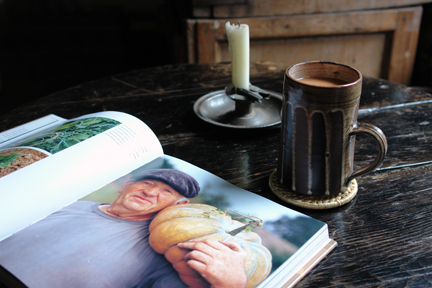 """photo of an old man holding a large pumpkin from """"The Way We Live In the Country"""" by Stafford Cliff & Gilles de Chabaneix with vintage Briglin mug and antique metal candleholder"""