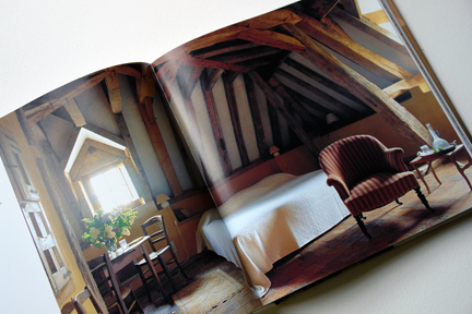 """attic bedroom with exposed rafters from """"The Way We Live In the Country"""" by Stafford Cliff & Gilles de Chabaneix"""