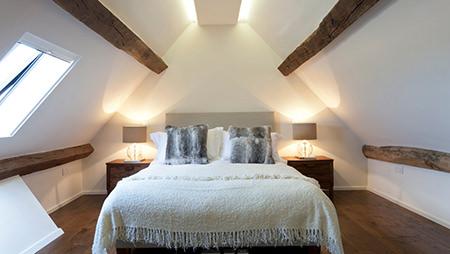 White-washed loft bedroom