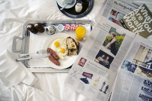 Breakfast and newspapers in bed