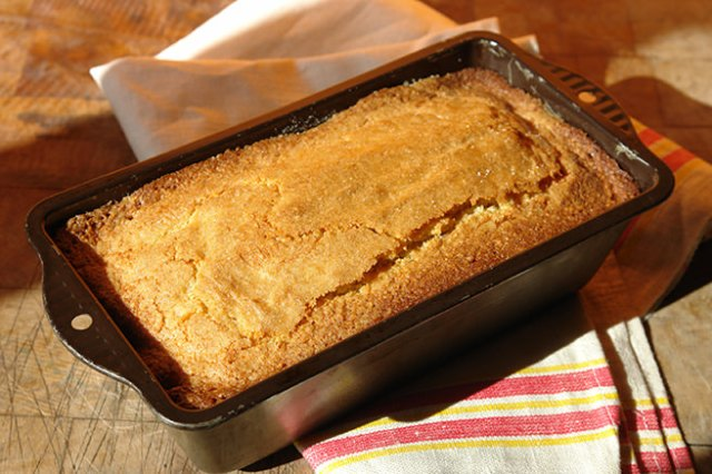 Cooked almond loaf cake in its tin   H is for Home