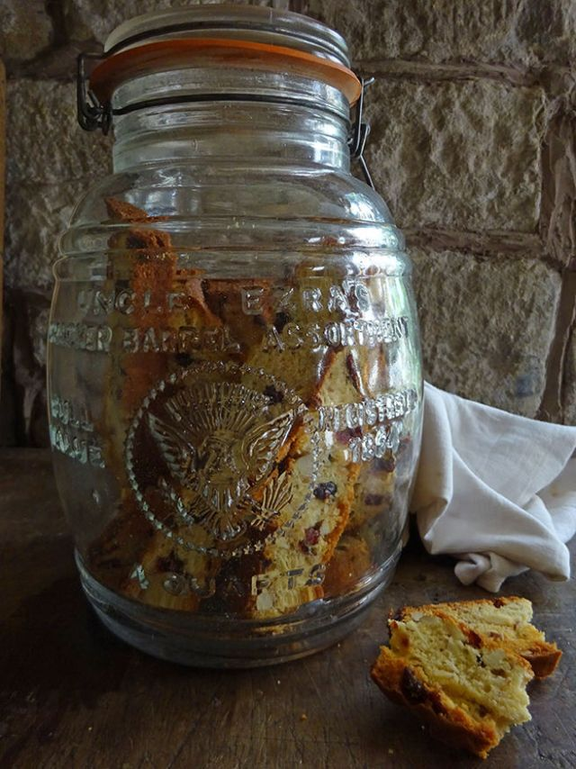 Home-made cranberry almond biscotti in a glass biscuit jar | H is for Home