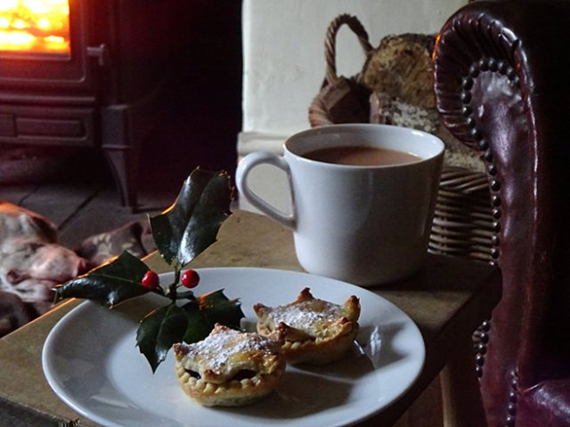 Plate of luxury mince pies and mug of tea in front of the fire | H is for Home