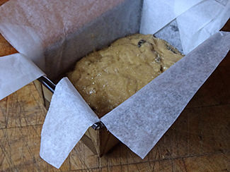 Prune tea loaf batter in a lined baking tin| H is for Home