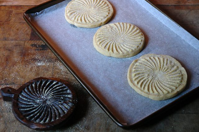 Three home-made shortbread rounds on a tray lined with parchment paper | H is for Home