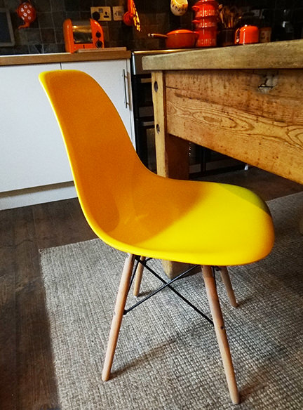 reproduction yellow DSW chair from Metro Furniture at our kitchen table
