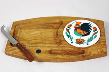 vintage cheese board with ceramic tile insert decorated with a cockerel