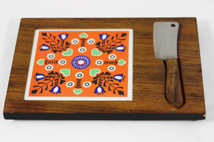 vintage cheese board with orange ceramic tile insert and knife