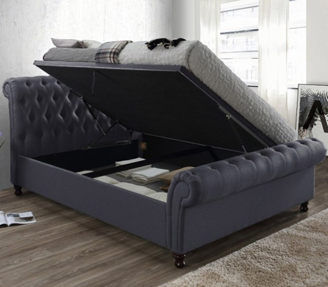 Grey buttoned ottoman bed