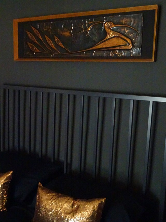 Vintage beaten copper artwork above the bed in our top-floor bedroom | H is for Home