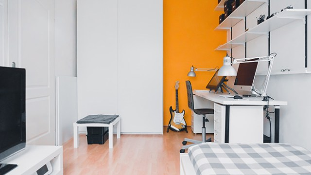 Home office with bright orange feature wall