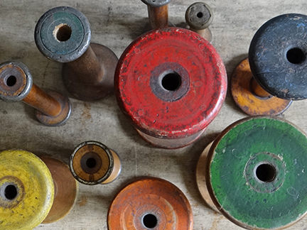 collection of vintage bobbins from above