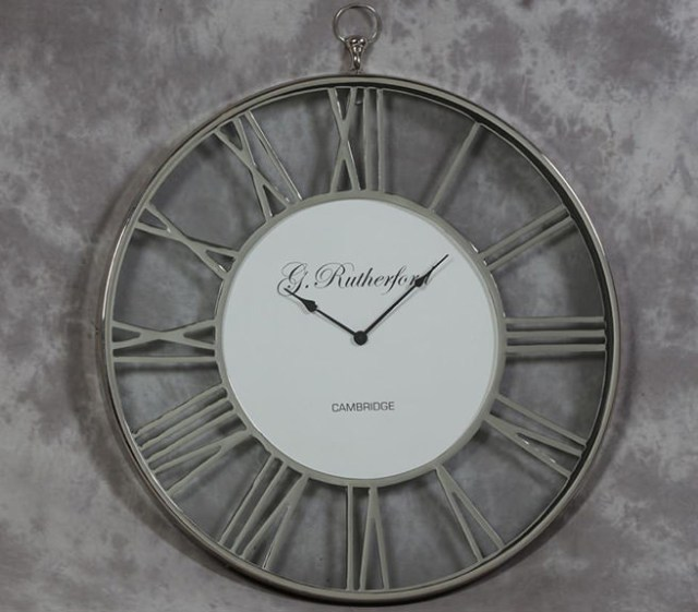 Medium nickel skeleton clock with glass fronted face