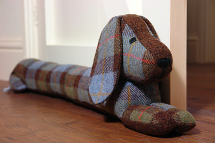 dachshund-shaped draught excluder handmade in Harris tweed by Queenie on Notonthehighstreet