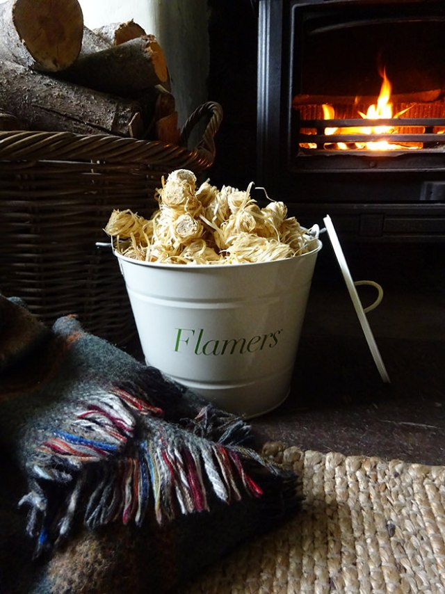 Bucket full of Flamers in front of our wood buring stove | H is for Home