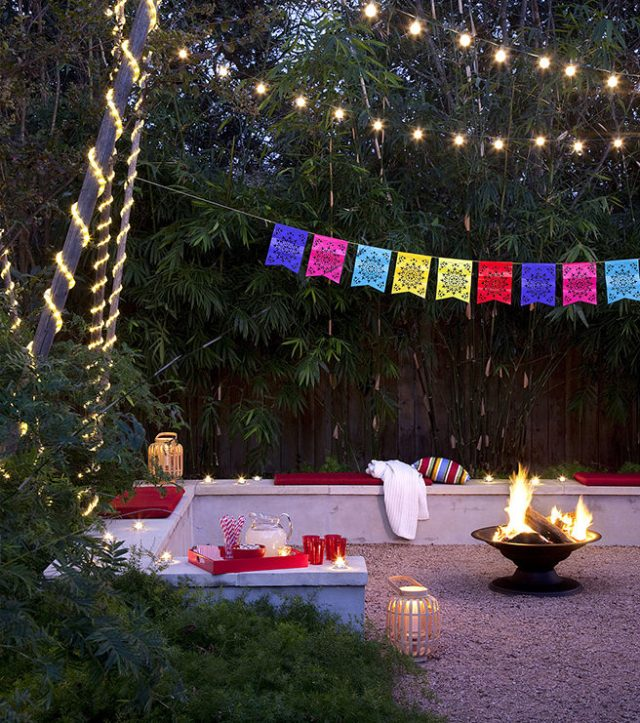 Patio garden with brazier and strings of lights and bunting
